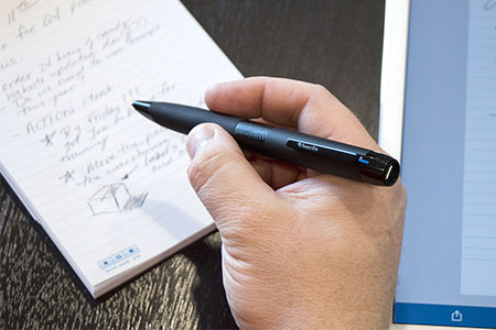 student with a smartpen